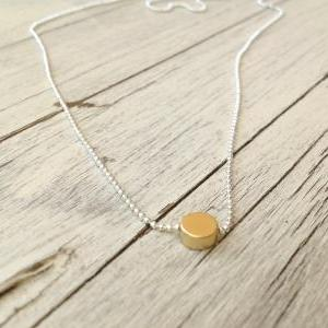 silver and gold necklace, gold dot ..